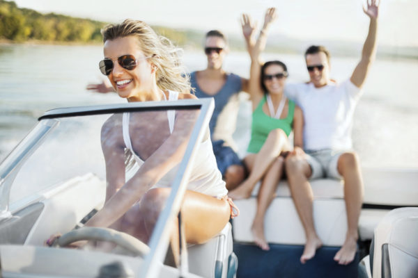 Cheerful blonde riding a speedboat, three young people in the background are sitting on the edge of the boat with raised arms.  [url=http://www.istockphoto.com/search/lightbox/9786750][img]http://dl.dropbox.com/u/40117171/summer.jpg[/img][/url]  [url=http://www.istockphoto.com/search/lightbox/9786786][img]http://dl.dropbox.com/u/40117171/couples.jpg[/img][/url]  [url=http://www.istockphoto.com/search/lightbox/9786738][img]http://dl.dropbox.com/u/40117171/group.jpg[/img][/url]